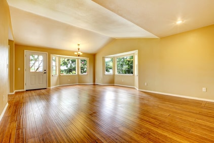 empty room of a house with clean shiny hardwood floors