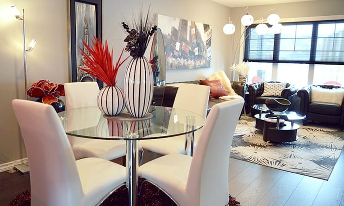 brightly lit living and dining area in an apartment