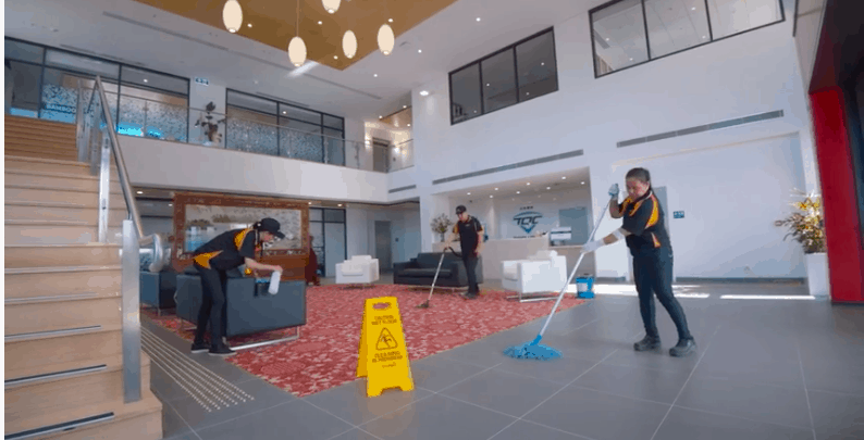 Janitors cleaning office lobby