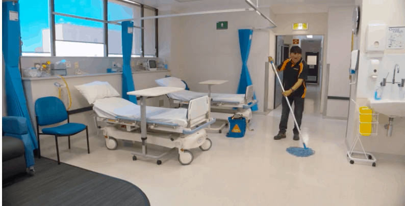 commercial cleaning servicejanitor mops hospital room floor