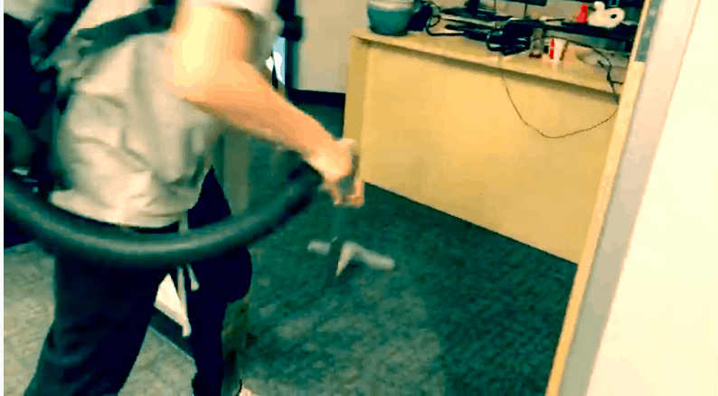 janitor vacuuming carpet in office