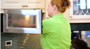 maid cleaning the inside of the microwave