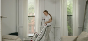 Maid vacuuming the carpet