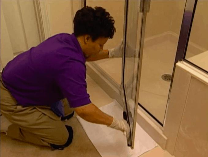 maid deep cleaning shower door