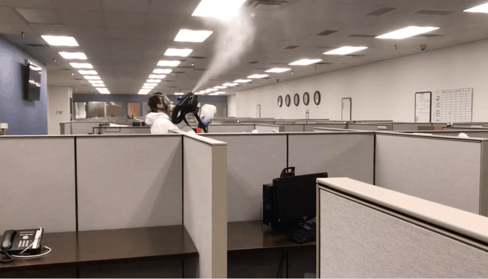 janitor sanitizing the air in an office space