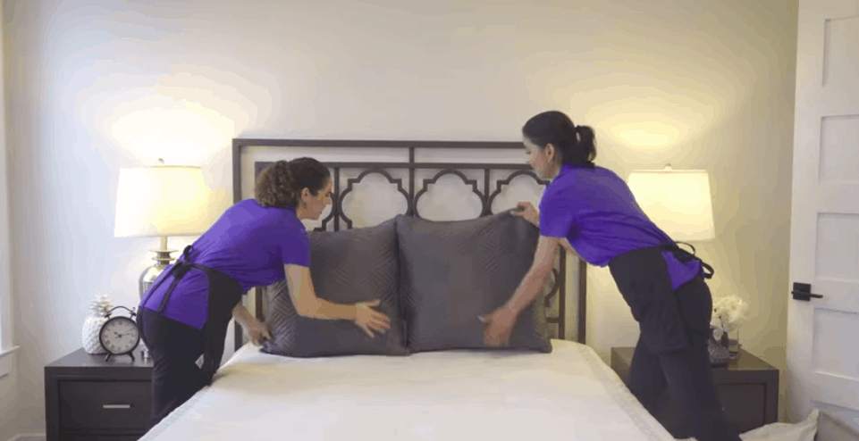two maids chasing a bed