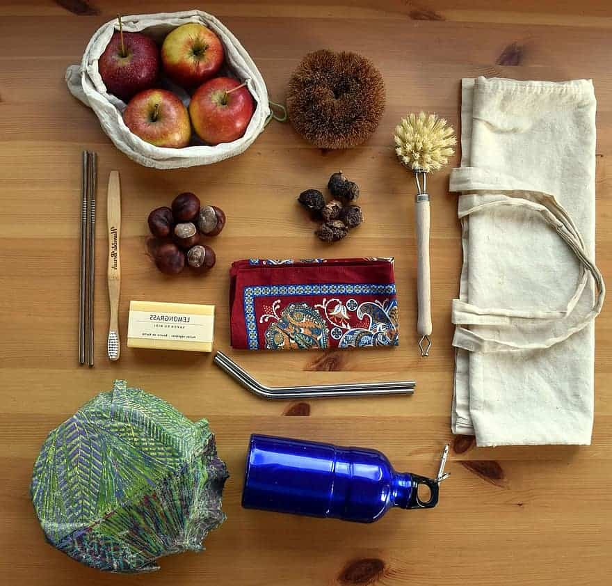 an assortment of eco-friendly gift ideas from reusable straws to bamboo totes