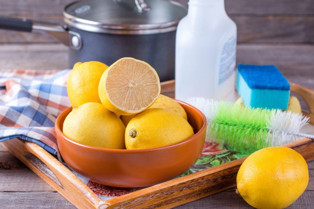 bowl of lemons with cleaning tools