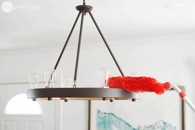 red high duster dusting a light fixture