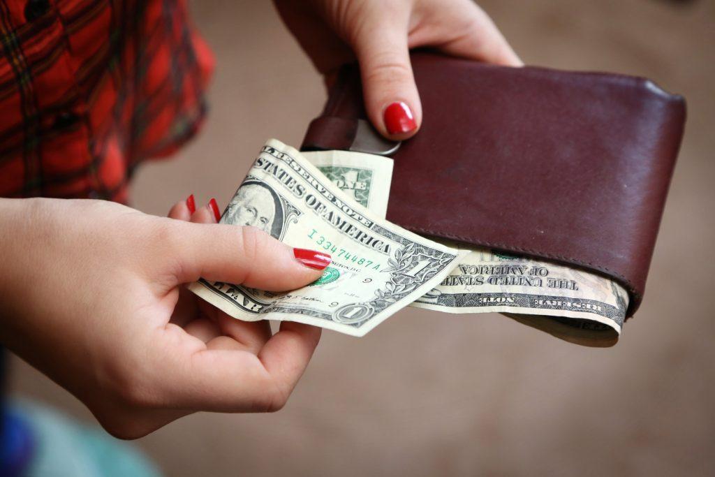female taking money of a wallet