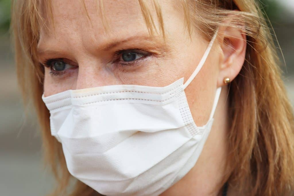 woman wearing white surgical mask