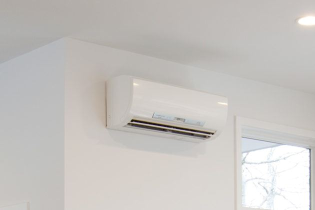 White split unit ac attached to wall