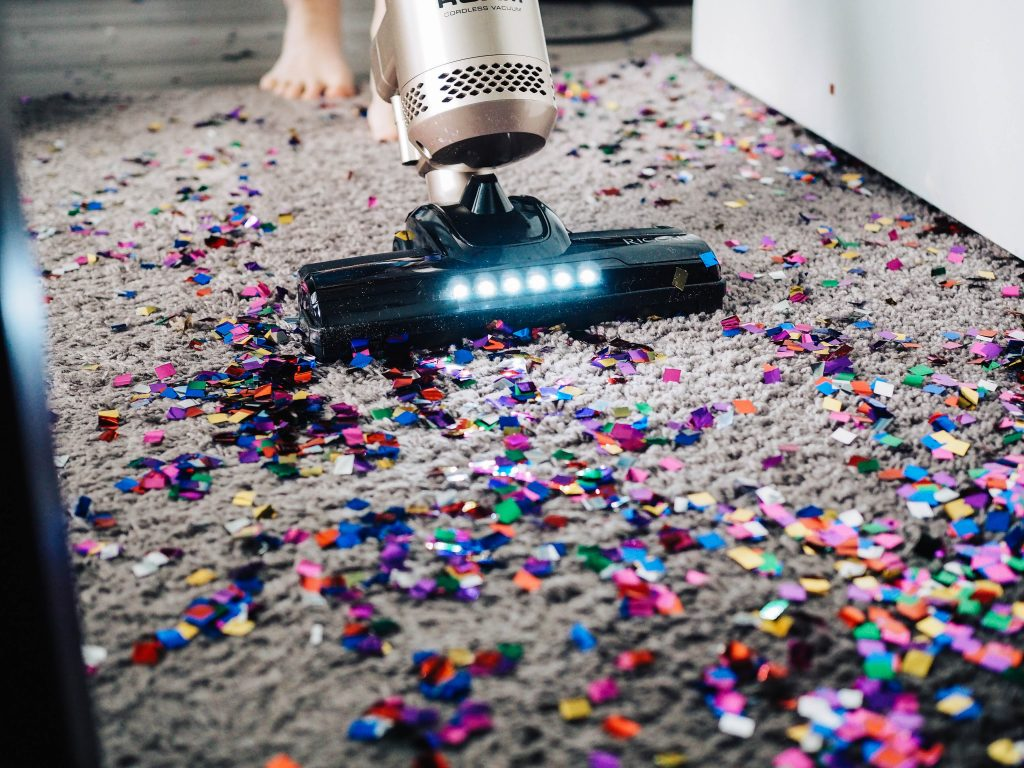 vacuuming confetti from the carpet